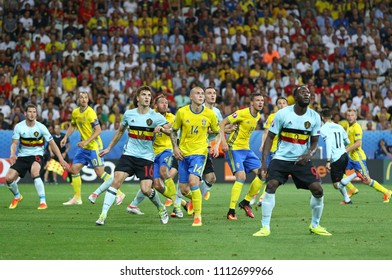 NICE, FRANCE - JUNE 22, 2016: Swedish (in Yellow) and Belgian players fight with each other for a ball during their UEFA EURO 2016 game at Allianz Riviera Stade de Nice, Nice, France. Belgium won 1-0