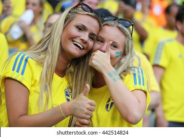 NICE, FRANCE - JUNE 22, 2016: Swedish fans show their support during the UEFA EURO 2016 game Sweden v Belgium at Allianz Riviera Stade de Nice, Nice, France. Belgium won 1-0