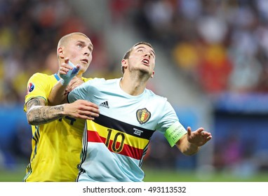 NICE, FRANCE - JUNE 22, 2016: Victor Lindelof of Sweden (L) fights for a ball with Eden Hazard of Belgium during their UEFA EURO 2016 game at Allianz Riviera Stade de Nice, City of Nice, France
