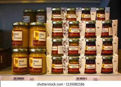 Nice, France - June 23, 2018: Jars of honey in store of France