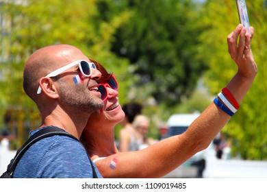 NICE, FRANCE - JUNE 26, 2016: Football fans enjoy the UEFA EURO 2016 football championship in France