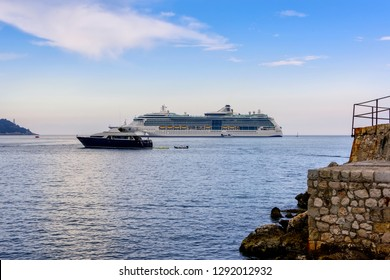 Nice, France - June 8, 2016:  Cruise ship and luxury yacht anchored in the harbor in Nice, France.