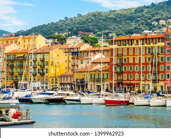 NICE, FRANCE - MAY 10, 2013: Old port of Nice. Yachts and fishing boats moored in the harbor of Nice, Cote d'Azur, France