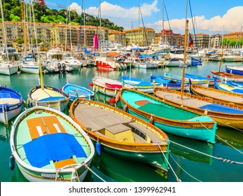 NICE, FRANCE - MAY 10, 2013: Old port of Nice. Multi-colored fishing boats in the harbor of Nice, Cote d'Azur, France