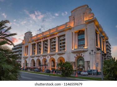 Nice, France - May 23, 2018: Palm trees and the famous Palais de la Mediterranee Art Deco hotel and casino by Hyatt on the Promenade des Anglais at sunset