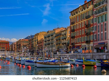 Nice, France - May 24, 2018: Old classic wooden boats, luxury yachts and traditional Mediterranean buildings in Lympia port of Nice, Côte d'Azur