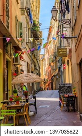 Nice, France - May 24, 2018: Traditional stores and quaint little restaurants in the old houses on narrow streets Old Town Vielle Ville Nice