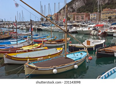 NICE, FRANCE - MAY 31, 2014: Colorful buildings and boats within a Port de Nice in French Riviera. Port de Nice was started in 1745.