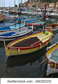 NICE, FRANCE - MAY 31, 2014: Colorful boats and buildings within a Port de Nice. Port de Nice was started in 1745.