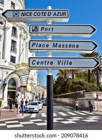 NICE, FRANCE - MAY 4: Road signpost against luxury Hotel Negresco on May 4, 2013 in Nice, France.