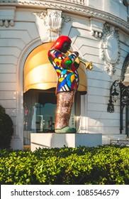 NICE, FRANCE - OCTOBER 11, 2009: Miles Davis statue by renowned artist Niki de Saint Phalle in front of Hotel Negresco