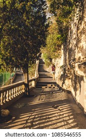 NICE, FRANCE - OCTOBER 12, 2009: Narrow walk during sunset in Castle Hill or Colline du Chateau park in Nice