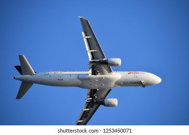 Nice, France - October 3, 2018: Close-up of a passenger plane in landing approach.