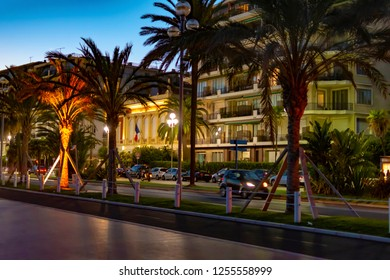 Nice, France - October 3, 2018: Street at the promenade in Nice, France, at dusk with colorful light effects.