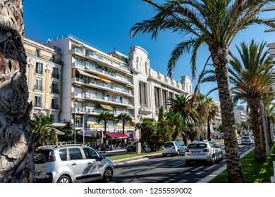 Nice, France - October 4, 2018: Street scene in Nice, France, with cars and palm trees.