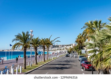 Nice, France - October 4, 2018: View from a sightseeing bus to the promenade of Nice, France, with the sea in the background.