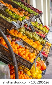 Nice, France - October 6, 2018: Baskets of fruit standing on a shelf in front of a shop on the sidewalk.