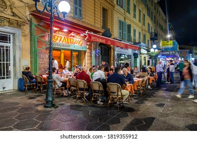 Nice, France, October 8, 2019. Urban view in the night. People have rest and eating in traditional street cafe