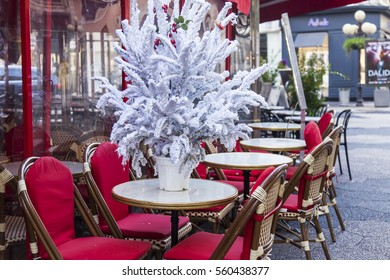 NICE, FRANCE, on JANUARY 6, 2017. The picturesque cafe decorated by a New Year tree on the city street
