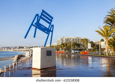 NICE, FRANCE, on JANUARY 6, 2017. The sun lights in evening of Promenade des Anglais - the main embankment of the city, and the modern sculptural image of a symbol of the city