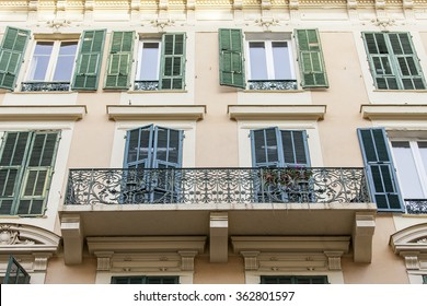 NICE, FRANCE, on JANUARY 7, 2016. Typical architectural details of houses in historical part of the city. Window and balcony.
