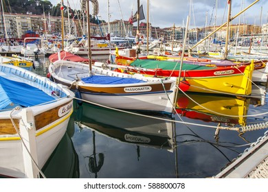 NICE, FRANCE, on JANUARY 8, 2017. The sun lights the numerous multi-colored boats moored in city port