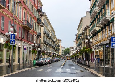 Nice, France, on July 3, 2011. Typical urban view in the summer afternoon. Tourists and citizens go down the street