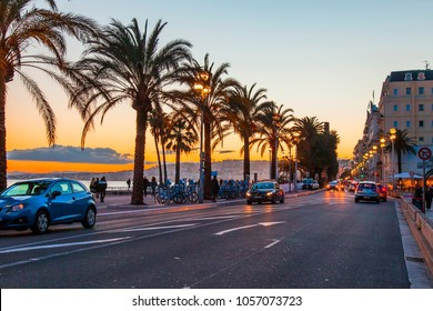 NICE, FRANCE, on March 10, 2018. A view of historical Promenade des Anglais, one of the most beautiful in a pattern lit with the sunset sun