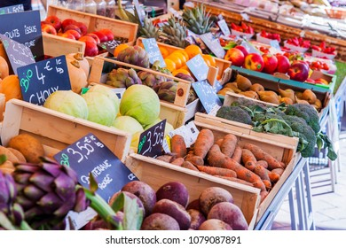 NICE, FRANCE, on March 7, 2018. Various vegetables and fruit are laid out on counters of the well-known Cours Saleya market