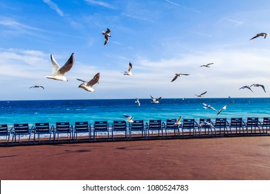 NICE, FRANCE, on March 7, 2018. Blue chairs for rest on Promenade des Anglais, one of city characters