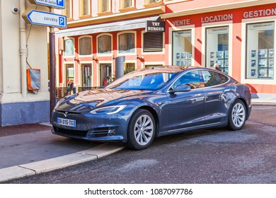 NICE, FRANCE, on March 7, 2018. The modern Tesla car on alternative fuel on the city street
