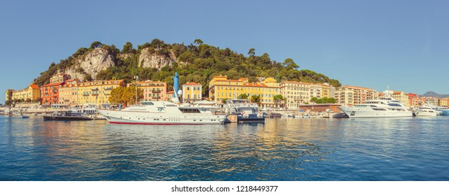 Nice, France, Panoramic view of the new yachts in the old port of Nice, Houses on the coastline and Castle hill