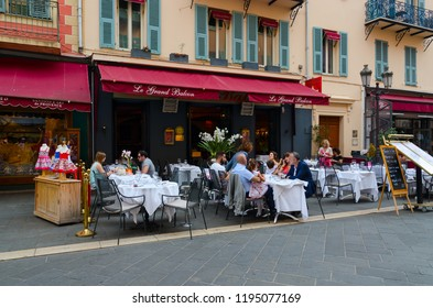NICE, FRANCE - SEPTEMBER 15, 2018: Unknown people relax at tables in outdoor French restaurant Le Grand Balcon in Old Town, Nice, Cote d'Azur, France