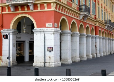 Nice, France - September 18, 2018: Colonnade of one of the big city houses located on Massena Square. The sidewalk hidden in the arcades of this colonnade provides shelter from the sun for pedestrians