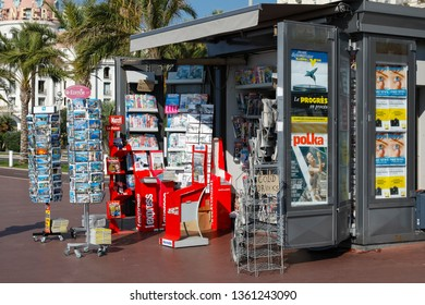 Nice, France - September 20, 2018: There is a kiosk on the Promenade des Anglais with magazines, newspapers and a selection of postcards, which are displayed here on external stands.