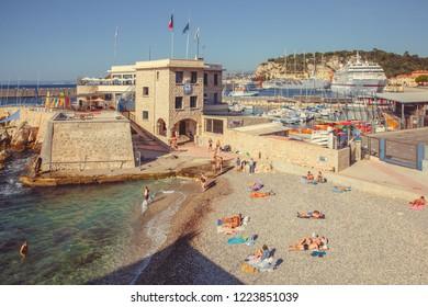 Nice, France - September 26, 2018: People sunbathe on the beach