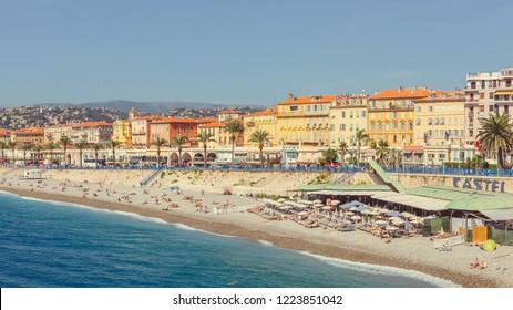Nice, France - September 26, 2018: People sunbathe on the small beach near port
