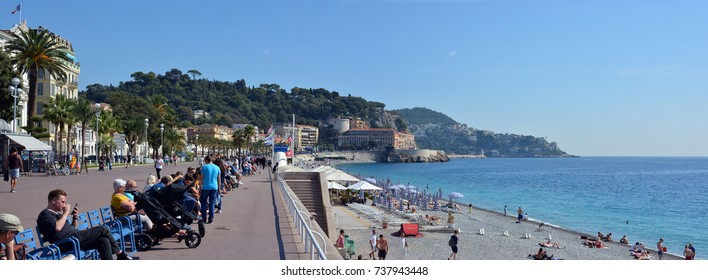 Nice, France - September 27, 2017: People sitting on the Promenade Des Anglais, Nice, France