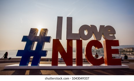 NICE, FRANCE – SEPTEMBER 29, 2017: Modern urban art on promenade of Nice made as hashtag #ILoveNice is popular photo and selfie spot for tourists.