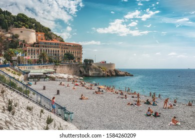 Nice, France, September 6, 2018: The public bath Plage de Castel with the Hotel Suisse in the background in the French city of Nice