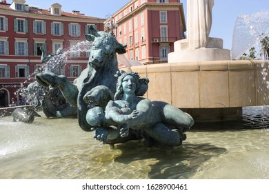 NICE, FRANCE-AUG. 18, 2017:  A detail of a fountain in the Place Massene of a raging bull and a woman fleeing with a child in her arms.