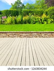 Nice garden with wooden terrace.