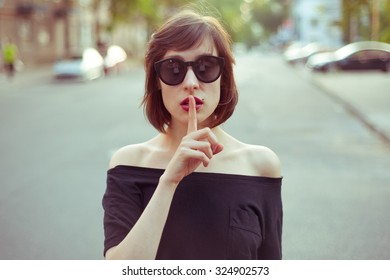 nice girl asking for silence in the street