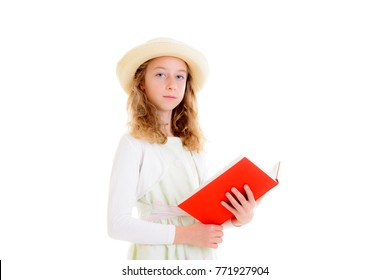 nice girl with blond hair in white dress and straw hat reading red book
