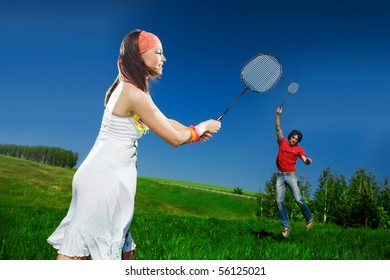 Nice girl and boy with rackets