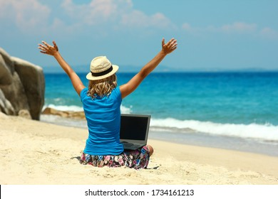 nice girl with laptop by the sea