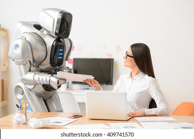 Nice girl and robot working in the office