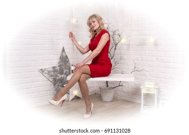 Nice girl in the room decorated for Christmas