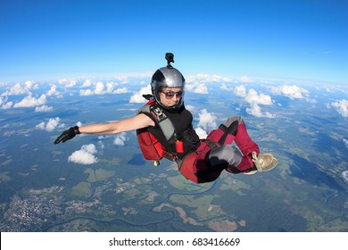 Nice girl is a skydiver in the sky.