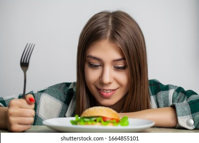 Nice girl wants to eat hamburger harmful
